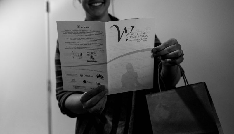 Woman Holding Pamphlet
